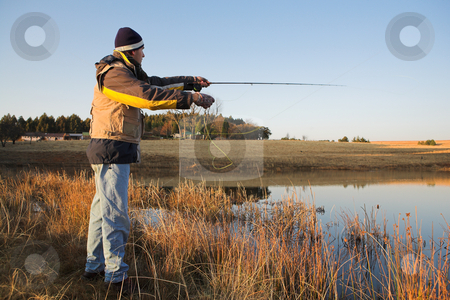 Flyfishing #16 stock photo, A fly fisherman casting a line in Dullstroom, South Africa by Sean Nel