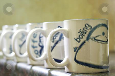 Coffee Mugs stock photo, Coffe mugs lined up by Sean Nel