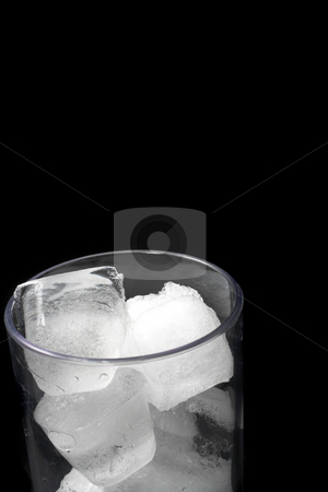 Glass #9 stock photo, Drinking glass filled with ice, black background - copy space by Sean Nel
