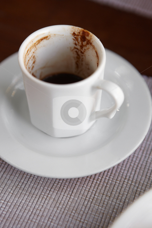 Turkish coffee stock photo, Small empty white cup of turkish coffee as served in a small rural cafe in Turkey. Very Shallow Depth of Field by Sean Nel
