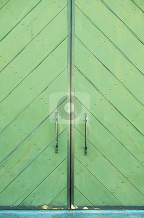 Green door of a building stock photo, Green door of a building with metal door handles and beautiful texture of paint by Sean Nel
