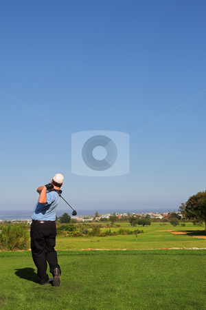 Golfer #68 stock photo, A golfer playing golf on a green.  Movement on the golf club. by Sean Nel