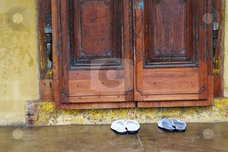 Shoes at the door stock photo, Slipper standing outside the door by Sean Nel