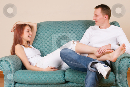 Trudy-Lee & Tommy #3 stock photo, Woman and boyfriend sitting on couch, talking by Sean Nel