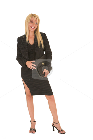 Sexy blonde businesswoman stock photo, Sexy young adult Caucasian businesswoman in black pinstripe pencil skirt and suit jacket on a white background. by Sean Nel