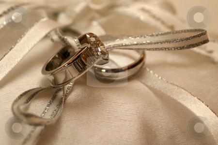 Rings on silk stock photo, Wedding rings lying on silk by Sean Nel
