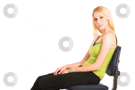 Businesswoman #468 stock photo, Blonde business lady in an informal green top. Sitting on an office chair.  Copy space. by Sean Nel