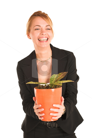 Businesswoman #242 stock photo, Blonde business lady in formal black suit.  Holding a potplant, laughing.  Movement - right eye in focus by Sean Nel