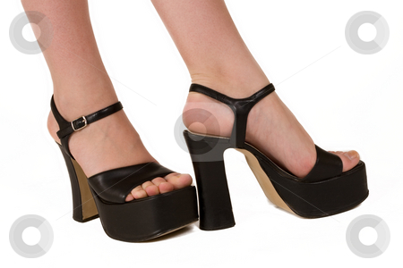 Fashionable feet 3 stock photo, Ladies feet in black high sole shoes by Sean Nel