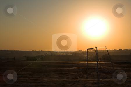 Rural soccer field stock photo, Sunset on rural football field after a game of soccer  by Sean Nel