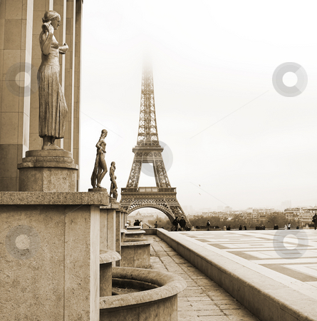 Paris #68 stock photo, A golden statue in the foreground with the Eiffel Tower in Paris, France.  Copy space.  Sepia tone. by Sean Nel