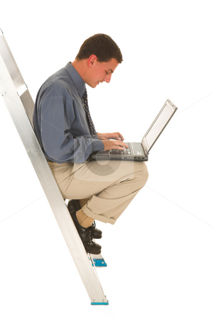 Businessman #43 stock photo, Man sitting on ladder working on laptop. by Sean Nel
