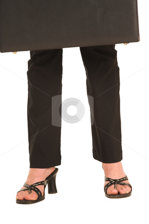 Business Woman #425 stock photo, Legs and feet of a business woman, holding a leather suitcase. by Sean Nel