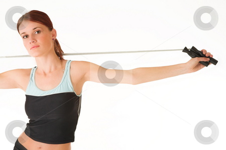 Gym #14 stock photo, A woman in gym clothes, exercising with a jumping rope by Sean Nel