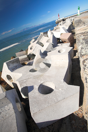 Storm break harbour wall stock photo, Big cement blocks (doloses) for storm water break outside the harbour wall, Kalkbay, Western Cape, South Africa  by Sean Nel