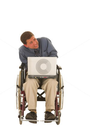 Businessman #134 stock photo, Man sitting in a wheelchair working on a laptop. by Sean Nel