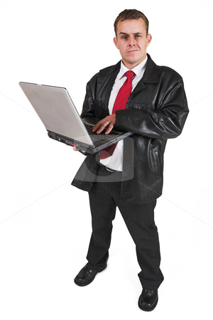 Businessman #49 stock photo, Business man standing with Notebook Computer by Sean Nel