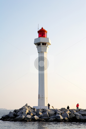 Cannes Lighthouse stock photo, The lighthouse at the edge of the harbor (Port Le Vieux) in Cannes, France by Sean Nel