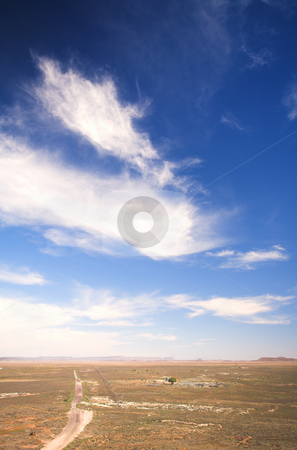 Blue sky over a dry desert landscape stock photo, Blue sky with dramatic clouds over a desert landscape, Hanover, South Africa by Sean Nel