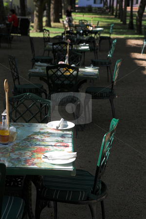 Outdoor restaurant stock photo, Empty tables at an outdoor restaurant in a tree lined courtyard - Shallow Depth of Field by Sean Nel