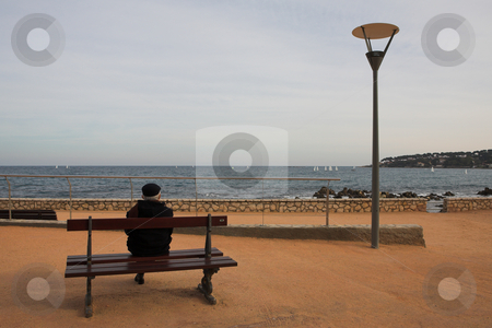 Benchman #01 stock photo, Man on Bench, next to the sea by Sean Nel