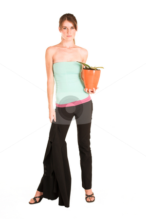 Business Woman #437 stock photo, Brunette business woman in  an informal light blue and pink shirt and black pants.  Holding a potplant and a jacket. by Sean Nel