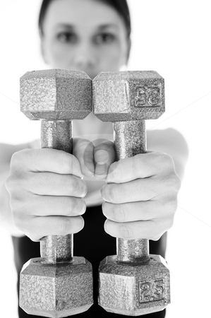 Gym #9 stock photo, A woman in gym clothes, holding weights out in front of her.  Shallow DOF  by Sean Nel