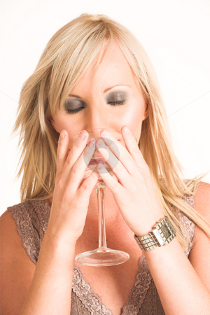 Business Woman #321 stock photo, Blond business woman dressed in a beige top.  Drinking out of a martini glass - eyes closed by Sean Nel