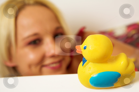 Woman #188 stock photo, Nude woman in a bath looking at a toy duck.  Shallow DOF by Sean Nel