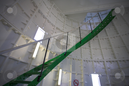 Spiral staircase inside a lighthouse stock photo, Green metal spiral staircase inside a white walled lighthouse by Sean Nel