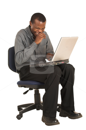 Businessman #156 stock photo, Businessman in grey shirt.  Sitting on an office chair, working on a laptop. by Sean Nel