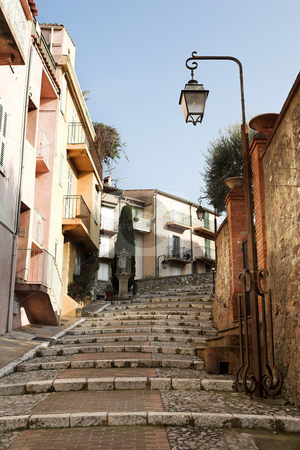 Street with walkway in Cannes stock photo, Street with buildings and paved brick walkway in Cannes, France by Sean Nel