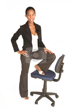 Mida Matsimela #21 stock photo, African business woman dressed in black jacket.  Standing.  One foot on a chair. by Sean Nel