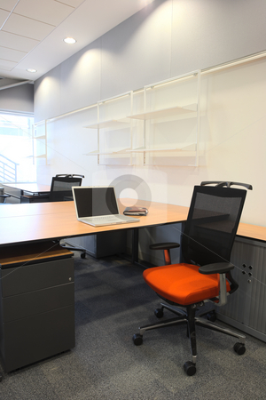 Interior of a new office stock photo, Empty office with new modern office furniture, including desks, cupboards, filing cabinets and chairs. With a notebook computer on the desk. HDR type image by Sean Nel
