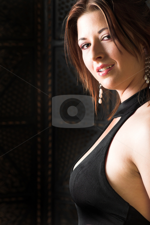 Young adult woman stock photo, Young Caucasian adult woman in a black evening wear  by Sean Nel