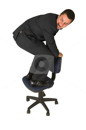 Businessman #233 stock photo, Businessman wearing a suit and a grey shirt.  Making a stunt on an office chair by Sean Nel