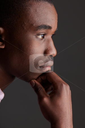 Black African businessman stock photo, Young Adult black african businessman wearing a dark smart-casual outfit without a Jacket, but with a pink shirt and a dark waistcoat on a dark grey background in various poses with various facial expressions. Part of a series, Not Isolated. Single lightsource, hard shadows by Sean Nel