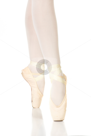 Ballet Feet Positions stock photo, Young female ballet dancer showing various classic ballet feet positions on Pointe against a white background - 4th position en pointe. NOT ISOLATED by Sean Nel