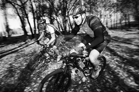 Mountainbiking #3 stock photo, Panning shot of two mountain bikers, racing in a forest.  Movement, some of the bikers in focus. by Sean Nel