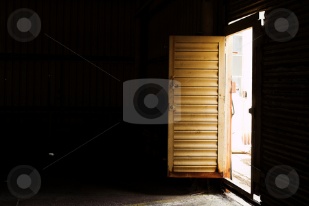 Inetrior #7 stock photo, Open door to an industrial warehouse - shaft of light, High contrast by Sean Nel