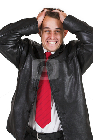 Tollie Booysen #1 stock photo, Businessman in black leather jacket, white shirt and red tie.  Holding his head. by Sean Nel