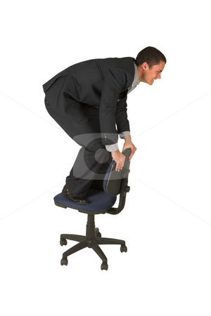Businessman #235 stock photo, Businessman wearing a suit and a grey shirt.  Making a stunt on an office chair. by Sean Nel