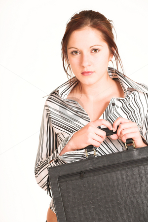 Business Woman #341 stock photo, Business woman with brown hair, dressed in a white shirt with black stripes. Holding a black leather suitcase. by Sean Nel