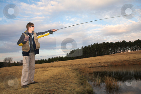 Flyfishing #11 stock photo, A fly fisherman casting a line in Dullstroom, South Africa by Sean Nel