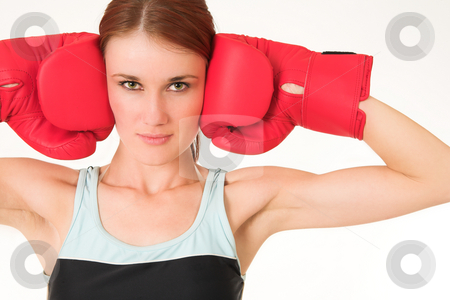 Gym #24 stock photo, A woman in gym clothes, wearing red boxing gloves. by Sean Nel