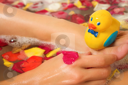 Woman #194 stock photo, Plastic toy duck on a woman's foot in the bath. by Sean Nel