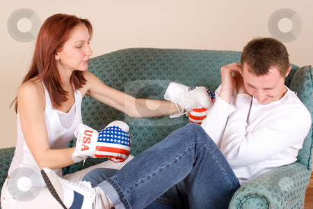 Couple #42 stock photo, Woman hitting her boyfriend with boxing gloves by Sean Nel