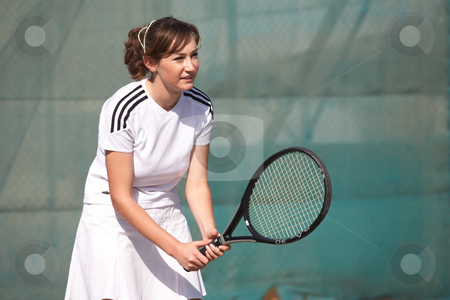 Female Tennis Players stock photo, Young women playing tennis in the sun by Sean Nel