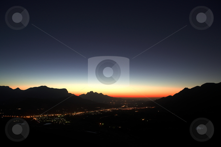 Sunset over Franschhoek  stock photo, Sunset over the small town of Franschhoek and nearby wine farms. Feint star trails in the sky right after sunset by Sean Nel