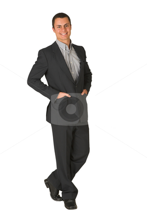Businessman #230 stock photo, Businessman wearing a suit and a grey shirt.  Standing  with both hands in his pockets, smiling. by Sean Nel